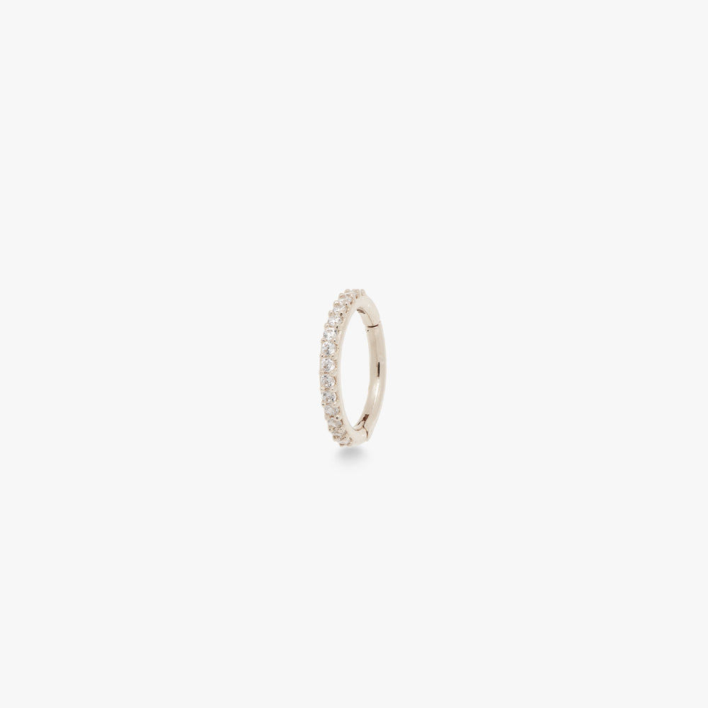 This clicker is a small 14k white gold hoop with CZ front accents that measures at 8mm. color:white gold/clear