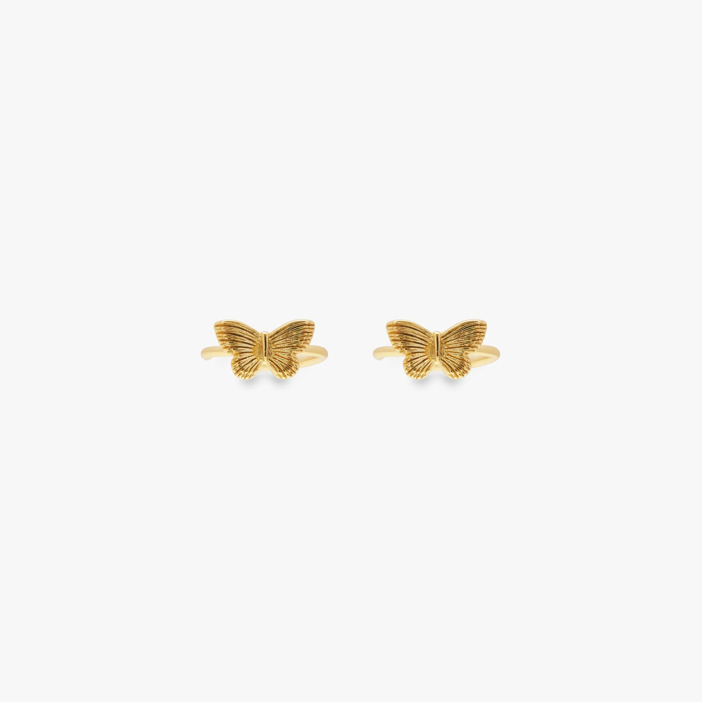Gold butterfly cuff.