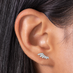 The wing pave crawler is a silver stud that climbs up the ear and is covered in clear gems.