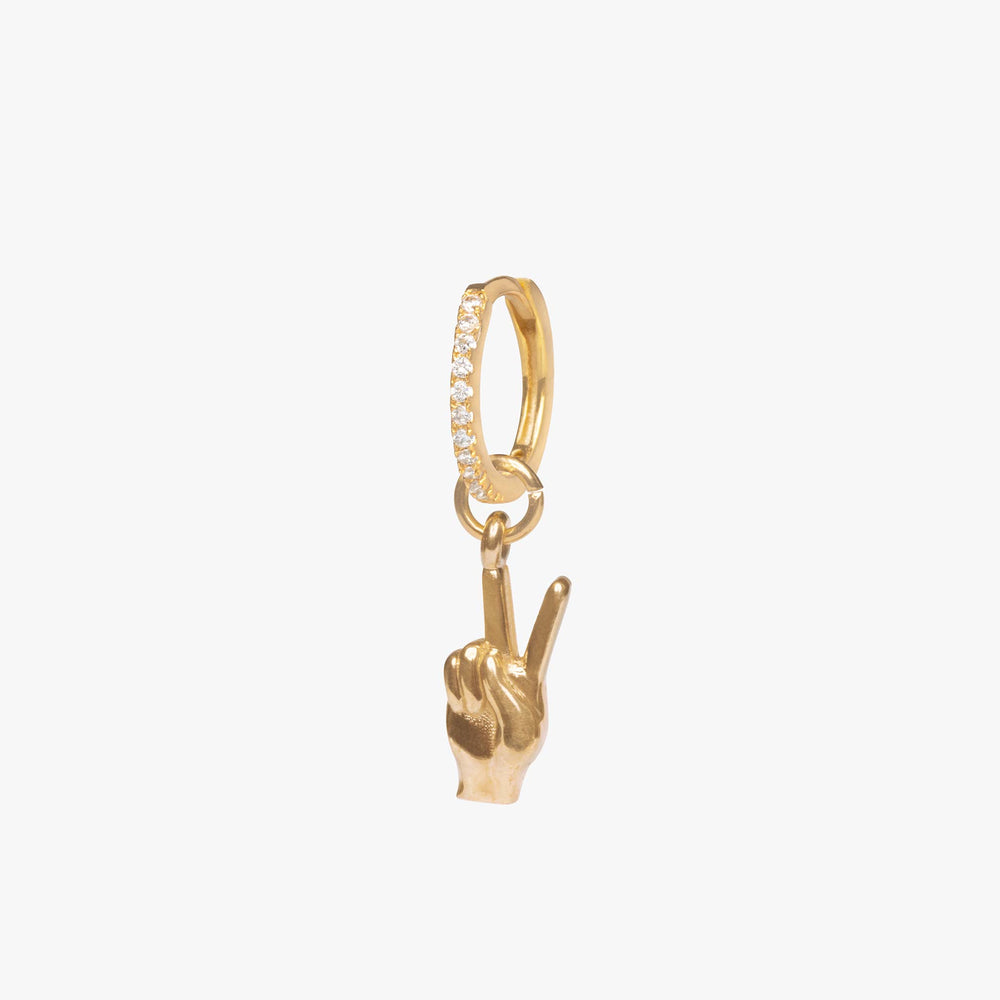Gold charm in the shape of a hand making a peace sign.