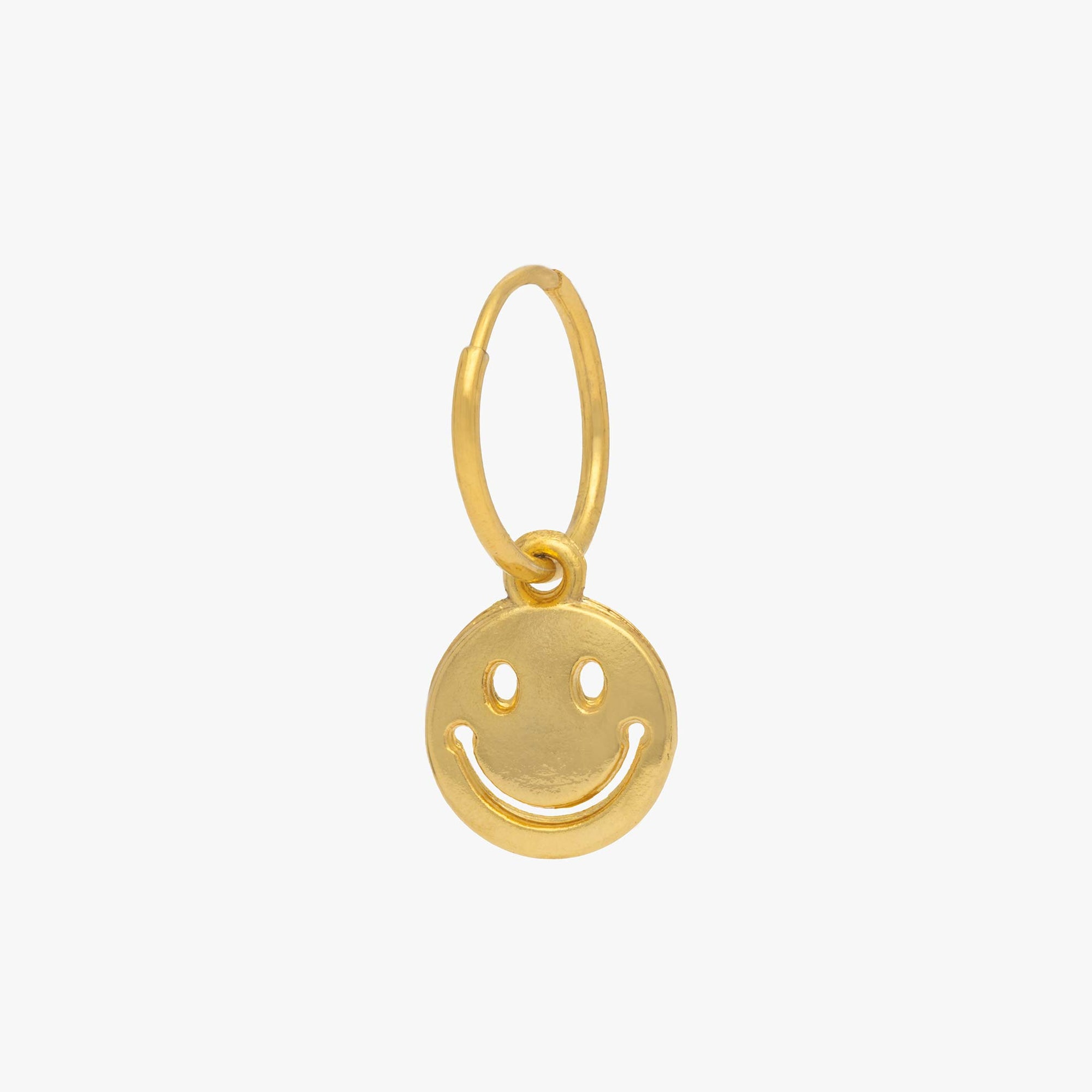 Smiley face charm in gold. color:gold