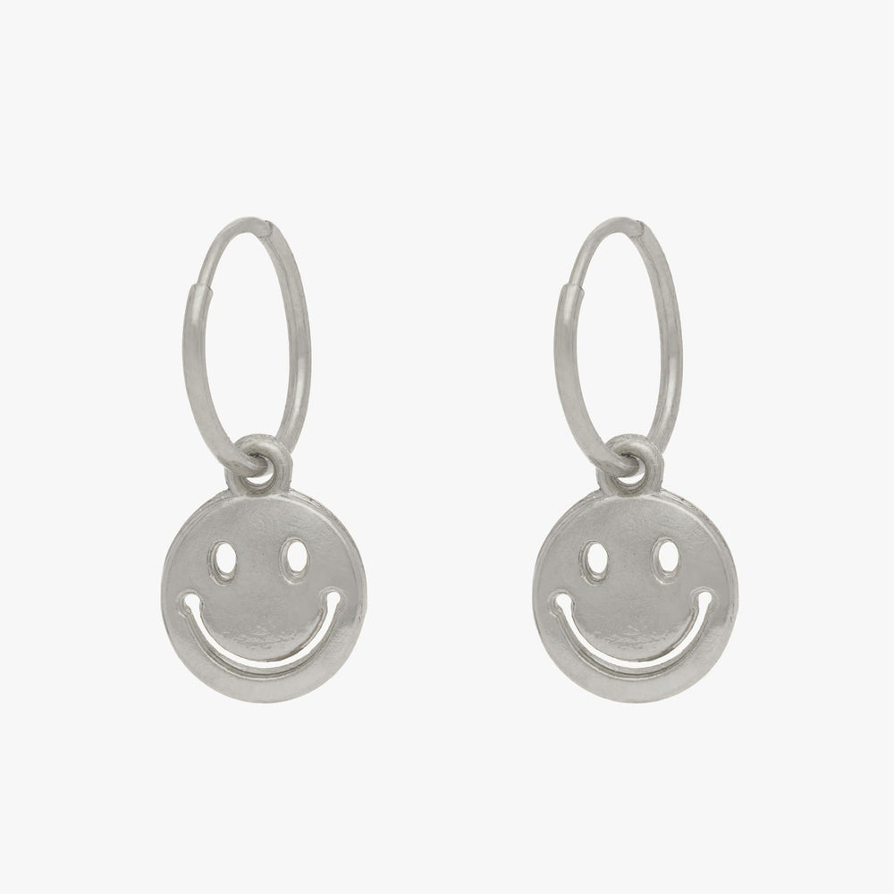 Smiley face charm in silver. [pair] color:silver