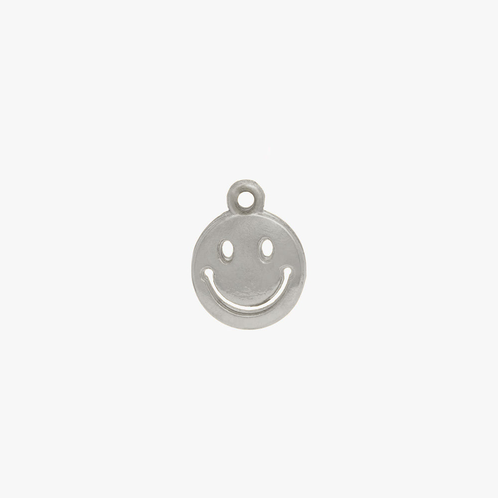 Smiley face charm in silver. color:silver