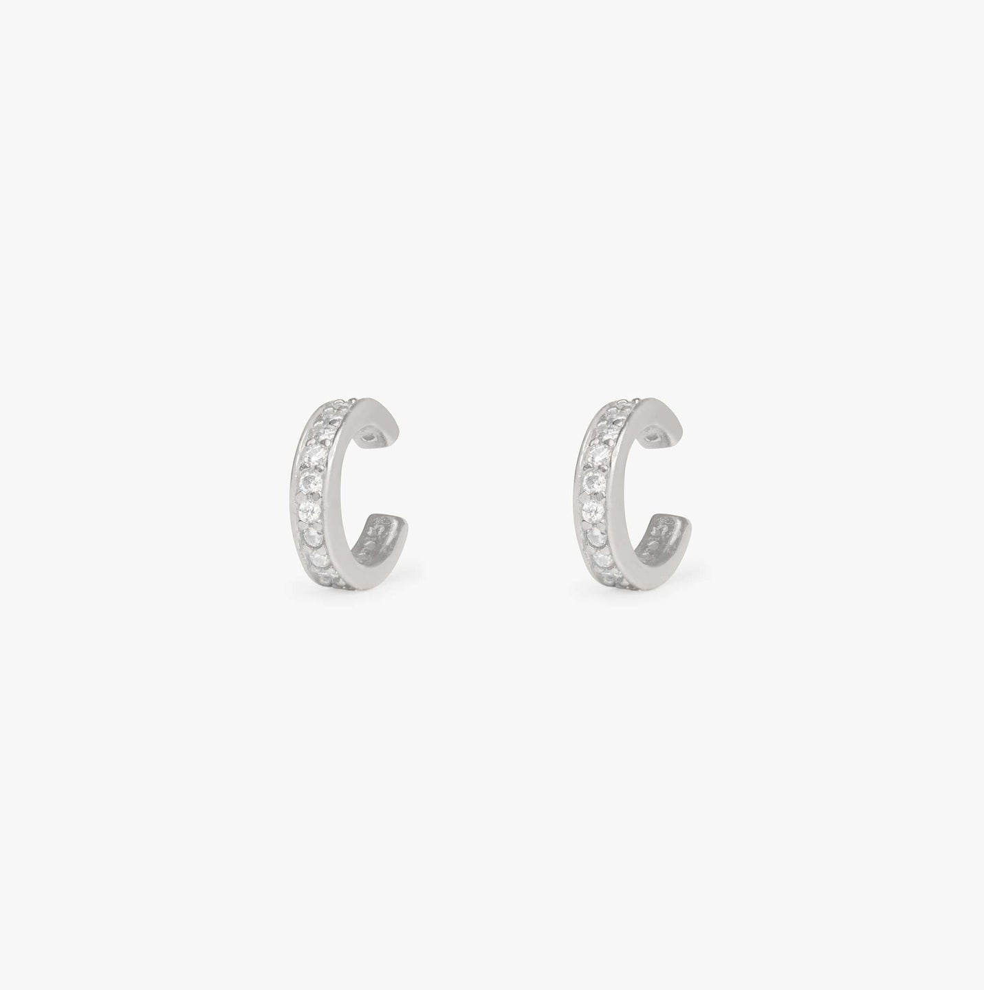 Silver ear cuff lined with CZ gems to be used without a piercing. [pair] color:silver / clear