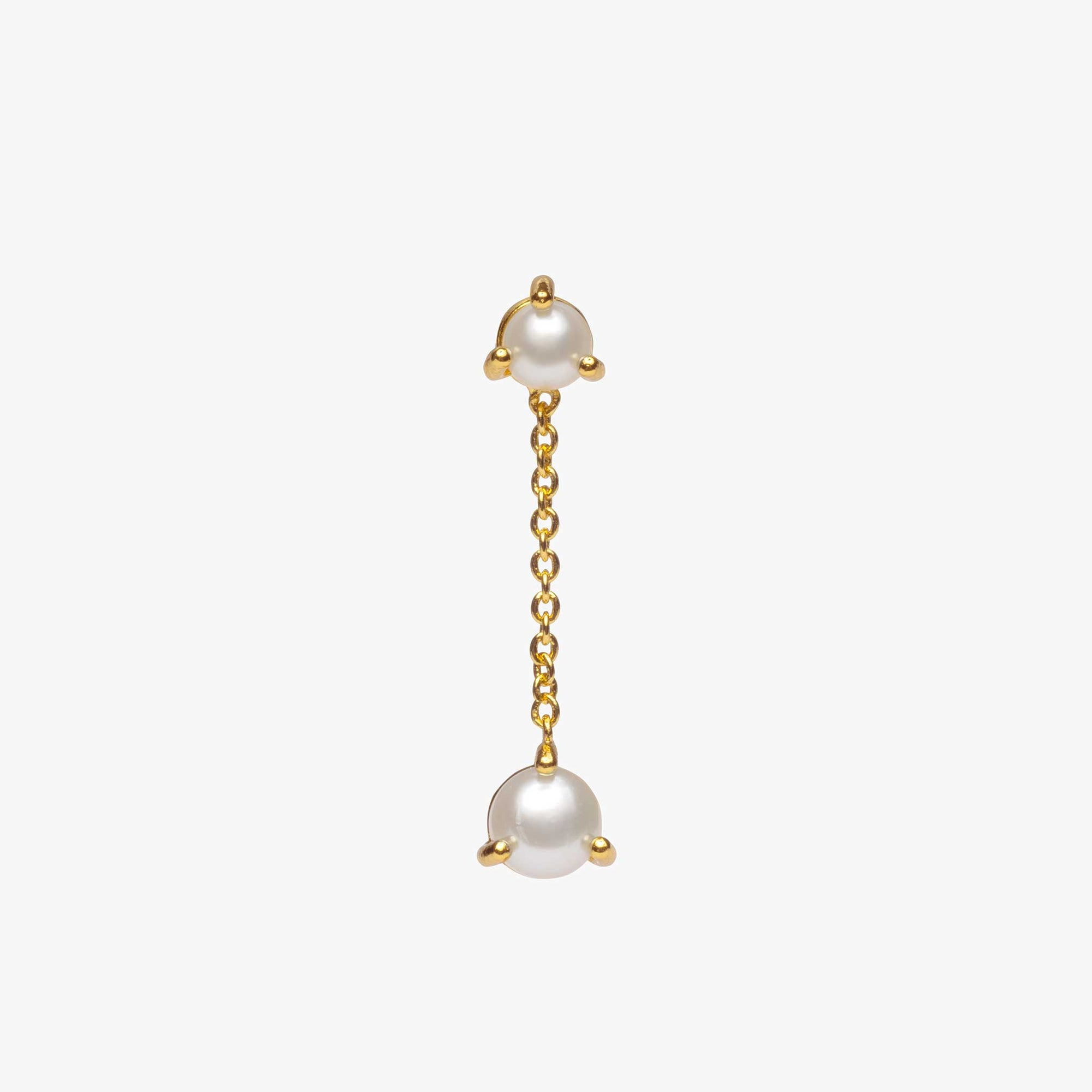 Pearl stud with gold chain dangle and an additional pearl at the end of the dangle chain.