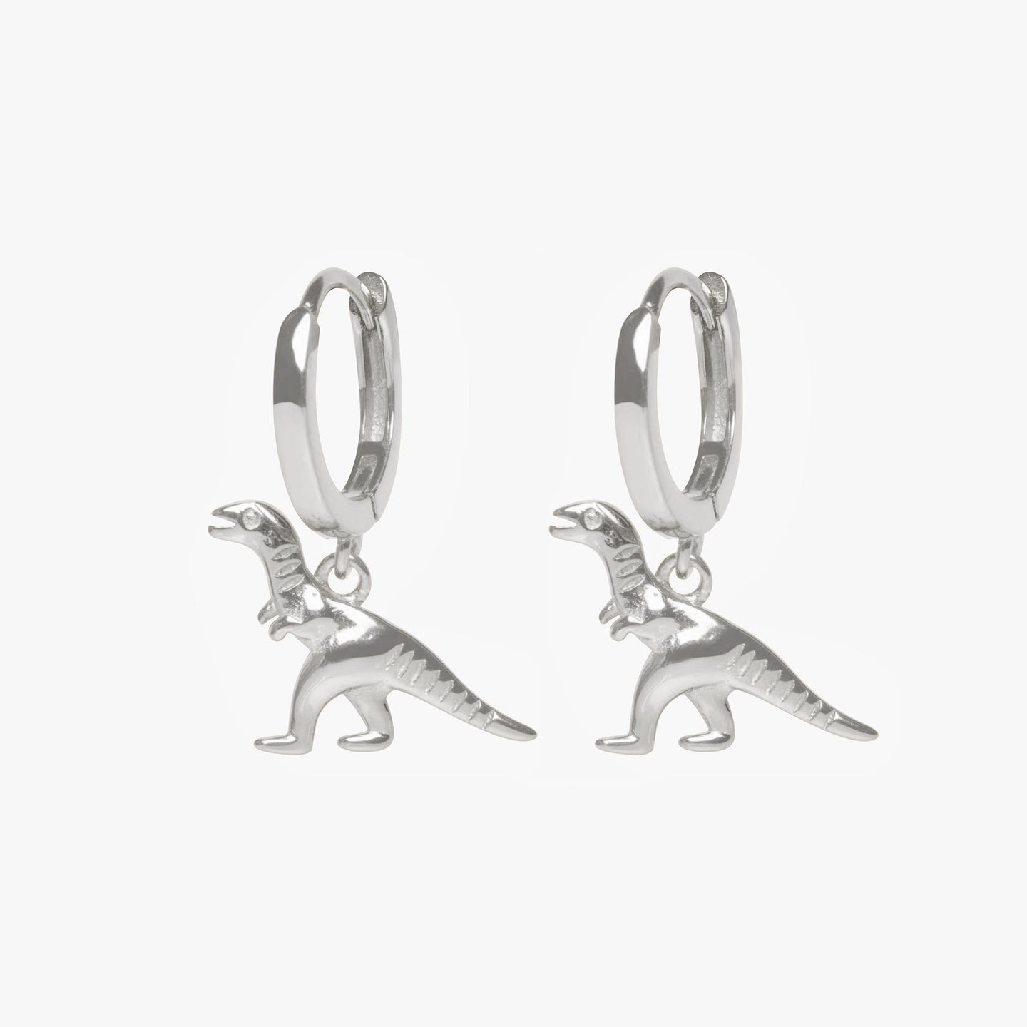 Dinosaur charm on a huggie. [pair] color:silver