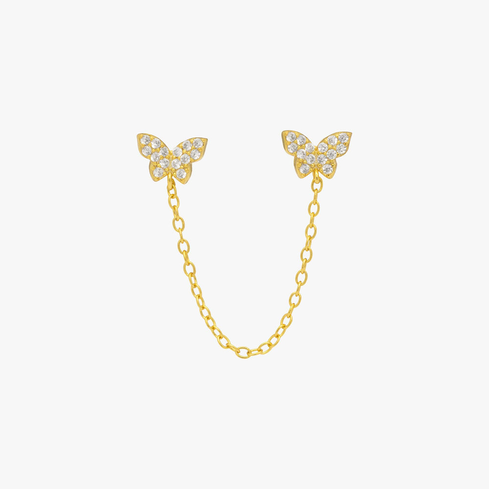 Two pavé butterflies in gold with attached gold chain. color:gold