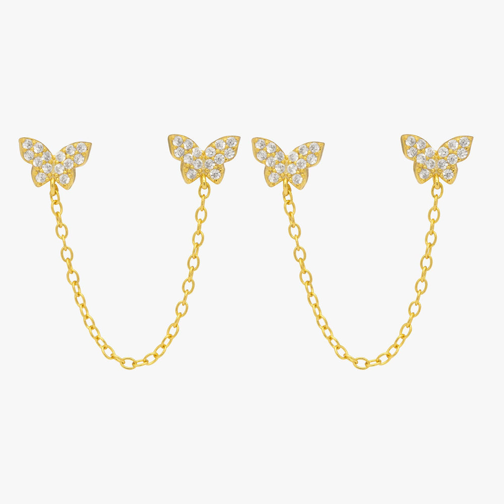 Two pavé butterflies in gold with attached gold chain. [pair] color:gold