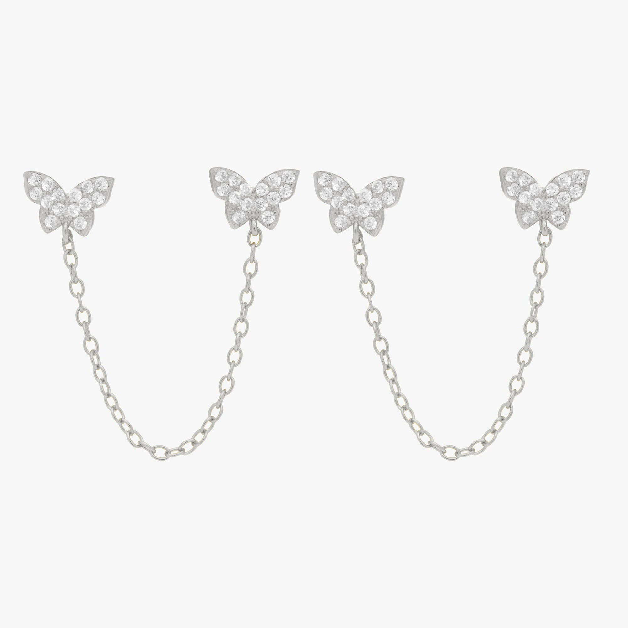 Two pavé butterflies in silver with attached silver chain. [pair] color:silver