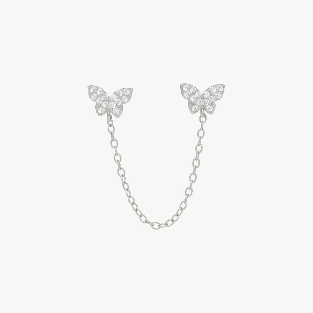 Two pavé butterflies in silver with attached silver chain. color:silver