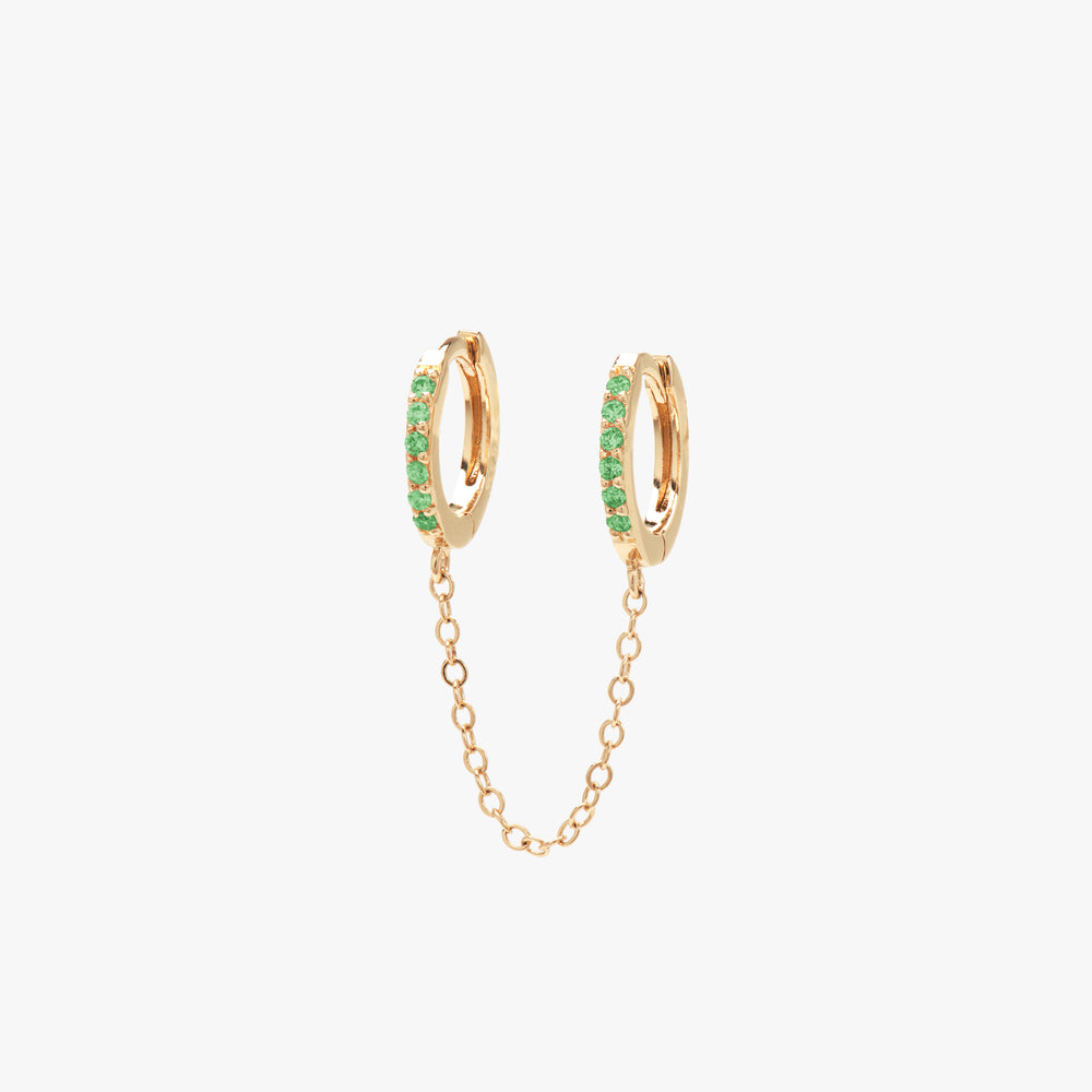 Two separate green CZ front huggies attached by a gold chain. color:gold/green
