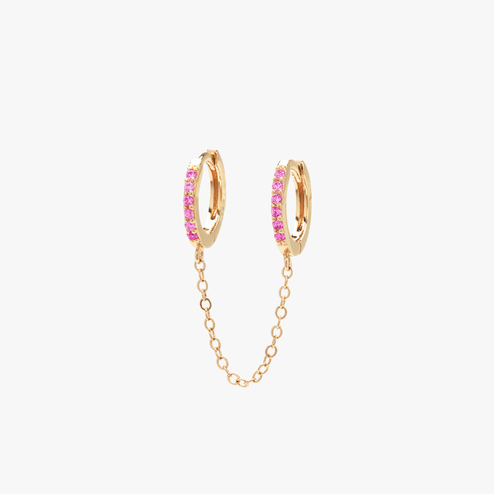 Two separate pink CZ front huggies attached by a gold chain. color:gold/pink