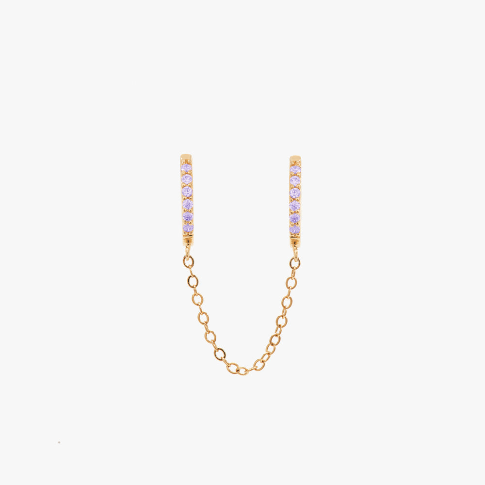 Two separate purple CZ front huggies attached by a gold chain. color:gold/purple
