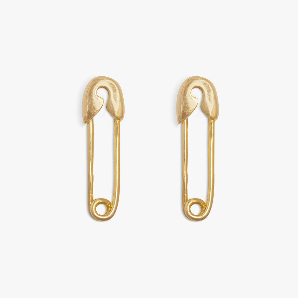 Small safety pin in gold with clear CZs lining top fastener.