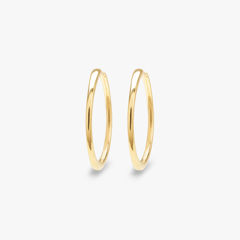 Slim gold large hoop pair photo. color:gold