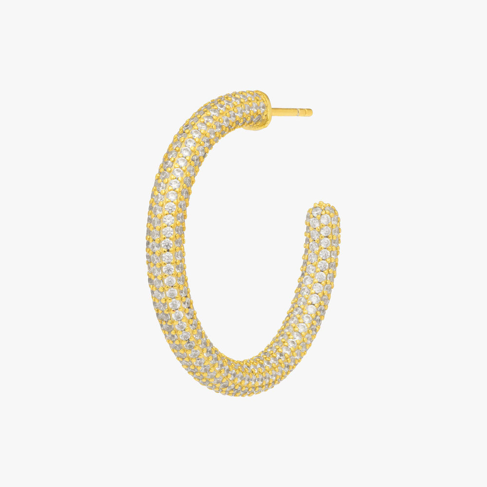 Tube-like hollow hoop with covered in CZs. color:gold