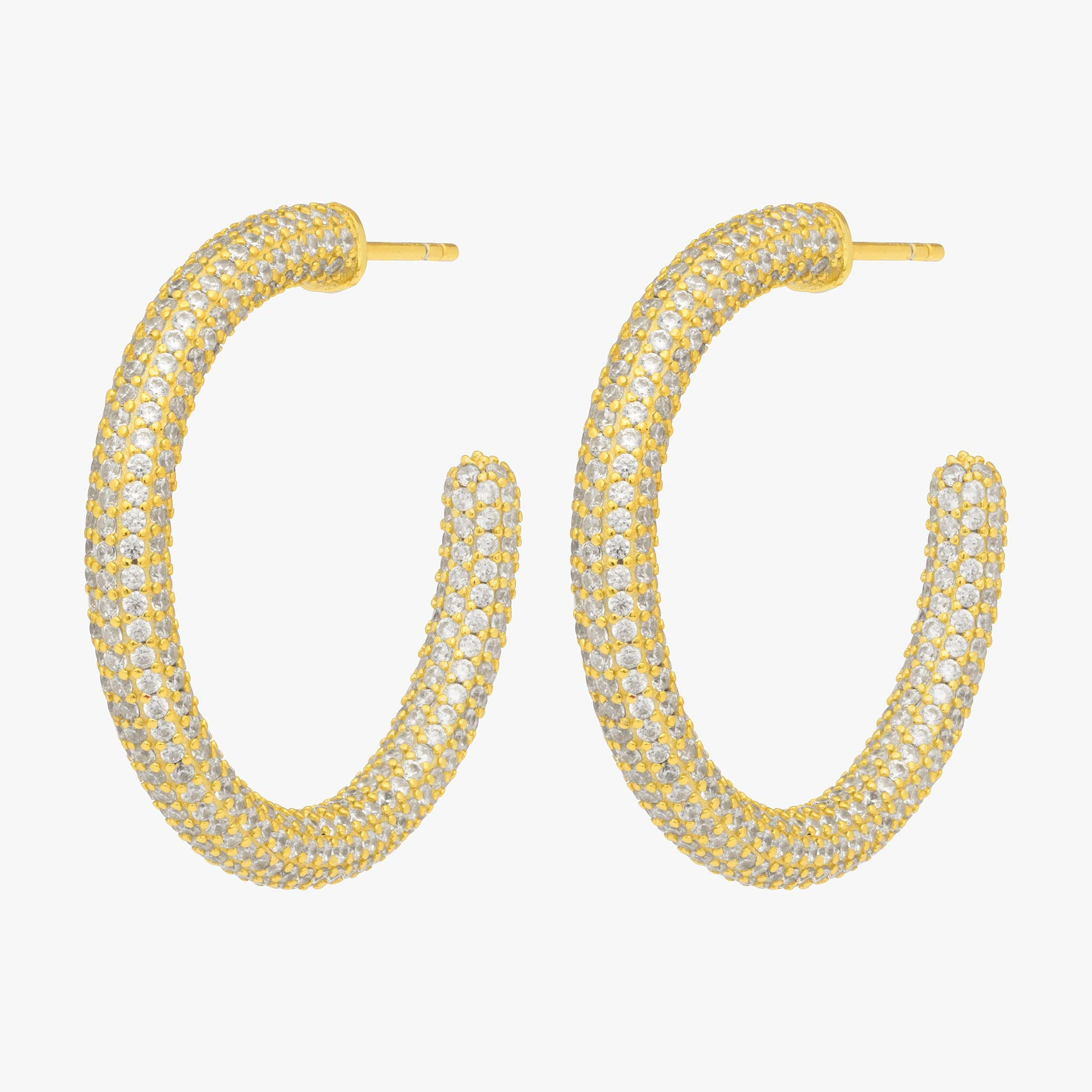 Tube-like hollow hoop with covered in CZs. [pair] color:gold