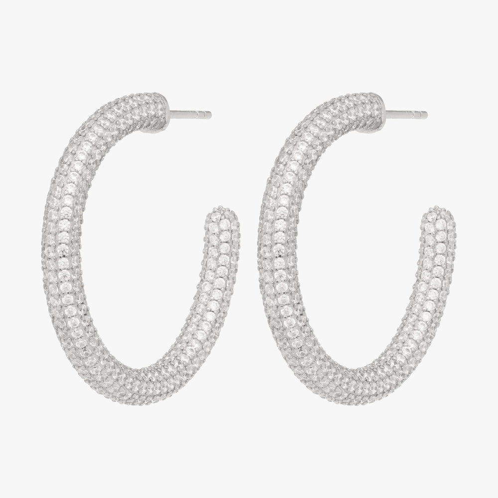 Tube-like hollow hoop with covered in CZs. [pair] color:silver