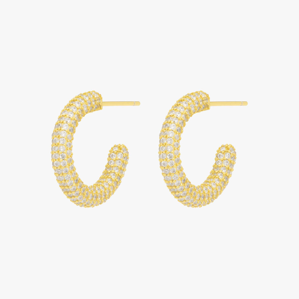 Tubular hollow gold hoop covered in clear CZs.