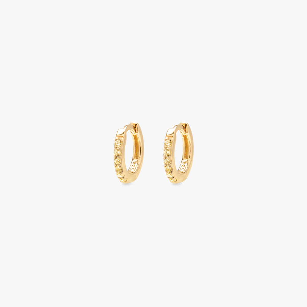 Miniature pavé huggie in gold with yellow gems. [pair] color:gold/yellow