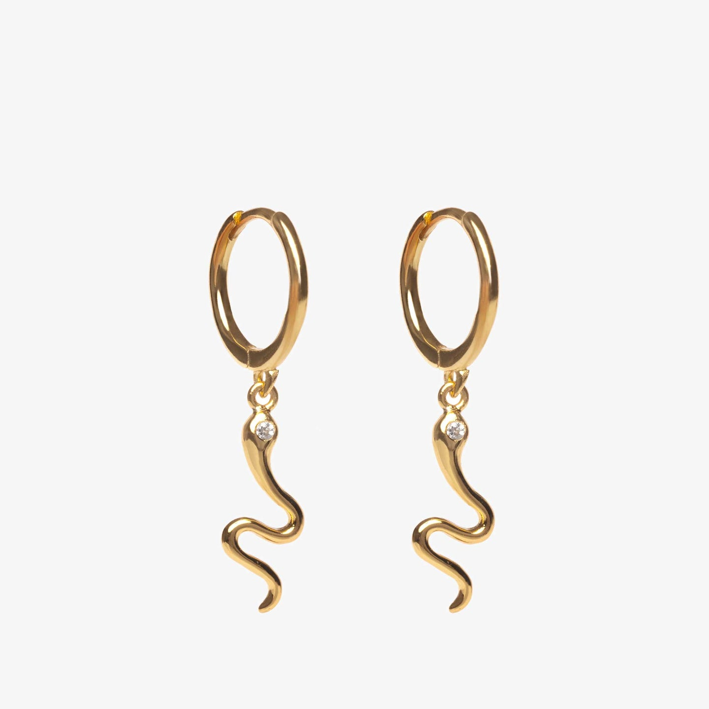 Serpent dangle in gold with a clear CZ eye on a gold huggie earring. [pair] color:gold / clear