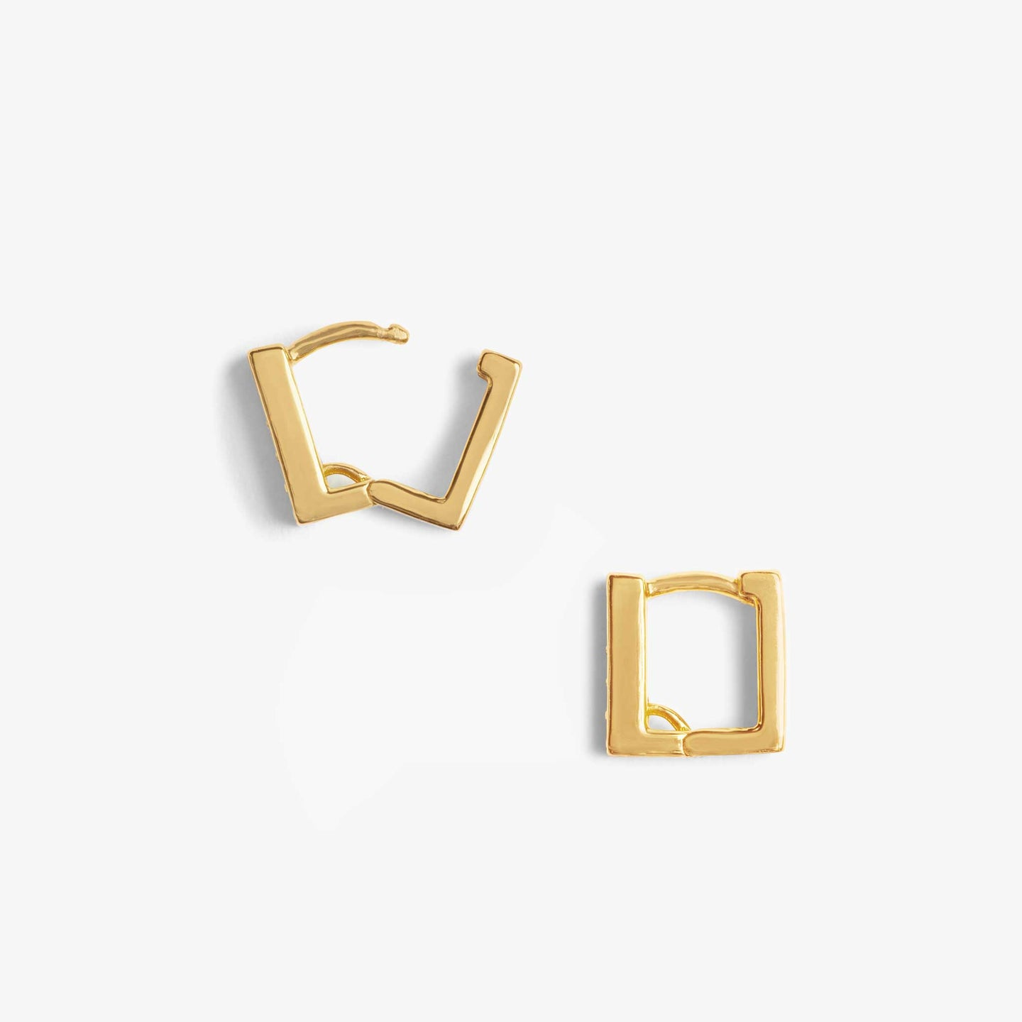 Gold pavé lined square shaped huggie.