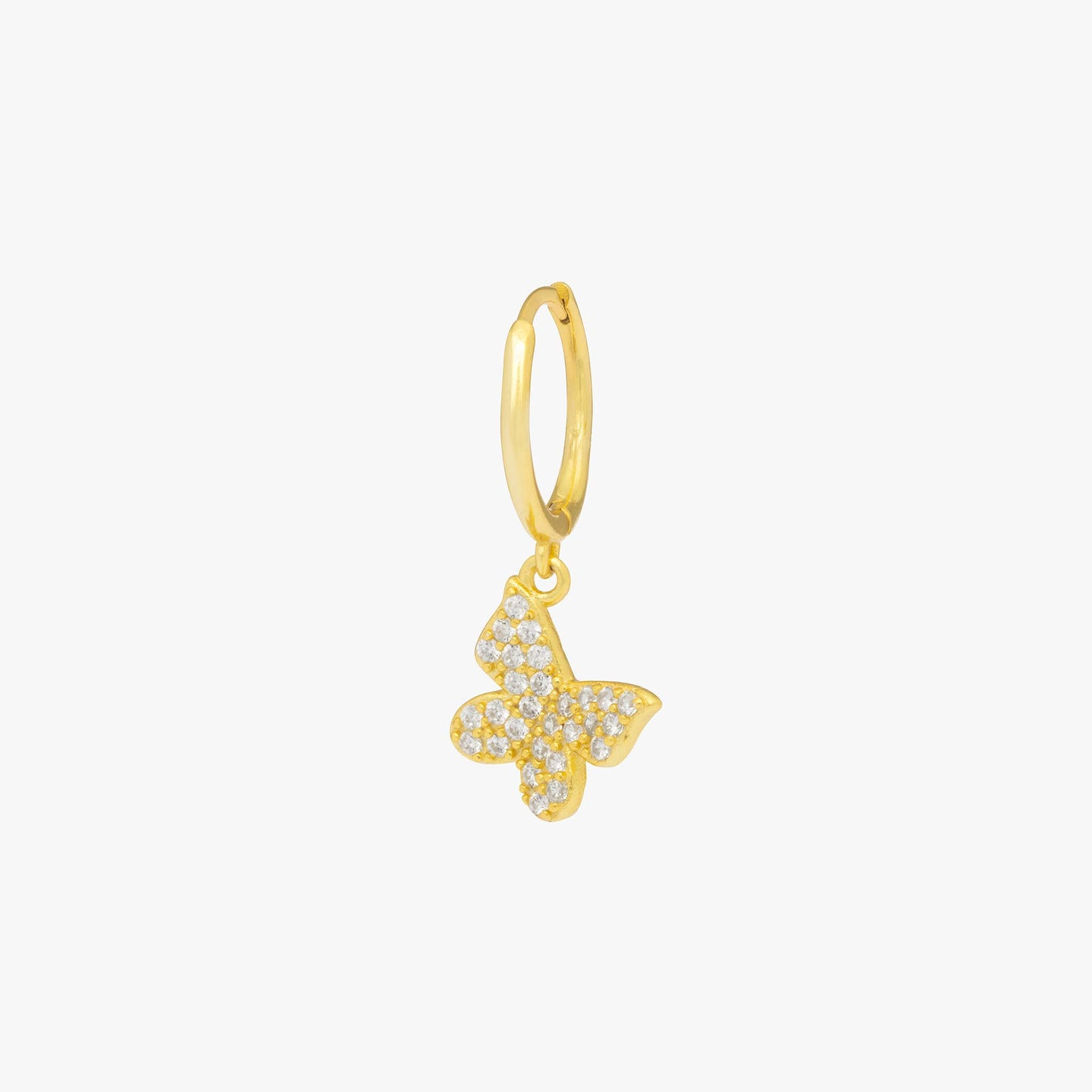 Pavé butterfly shaped charm on a gold huggie. color:gold