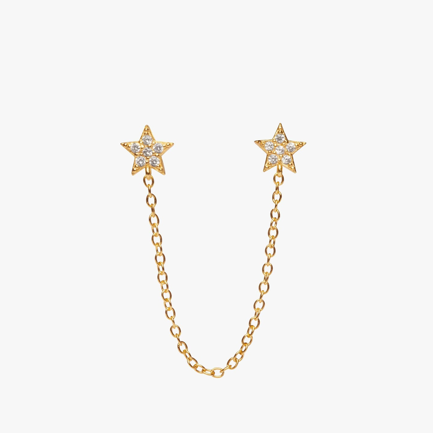 Two separate pavé star posts connected by a gold chain. color:gold