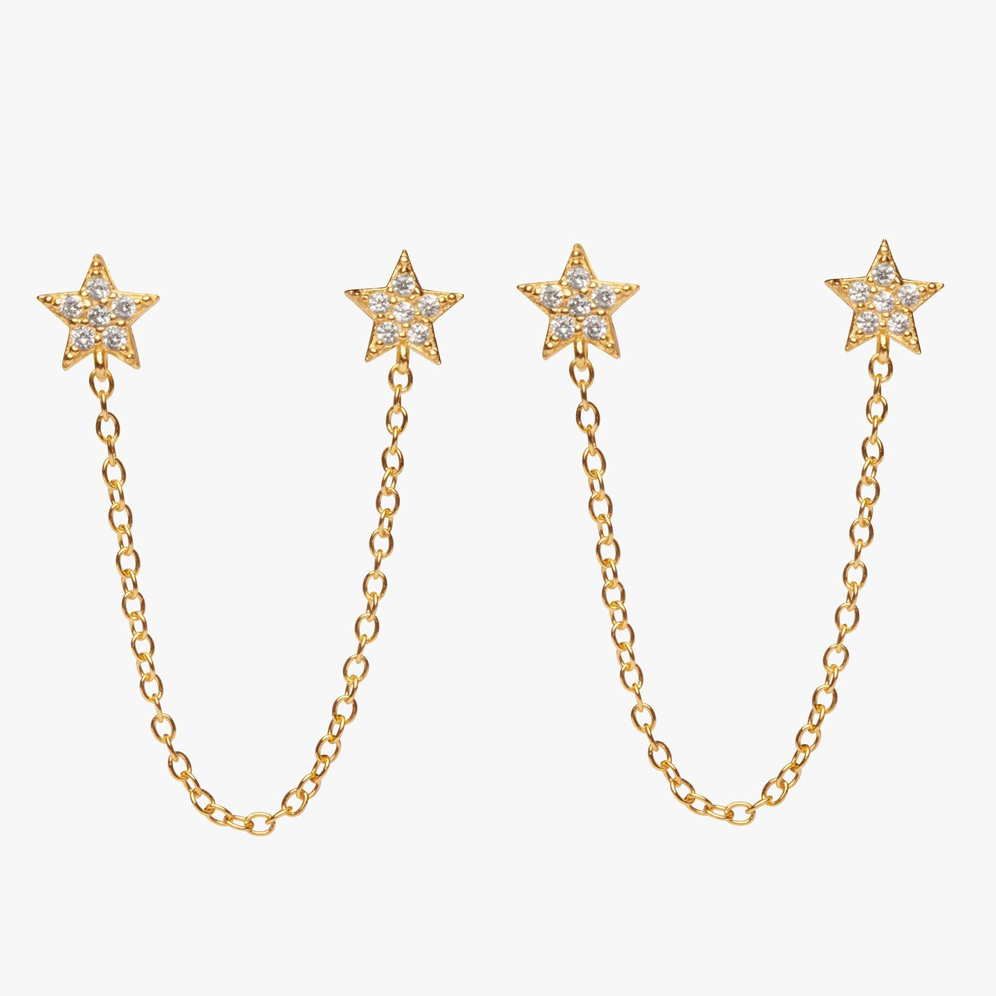 Two separate pavé star posts connected by a gold chain. [pair] color:gold