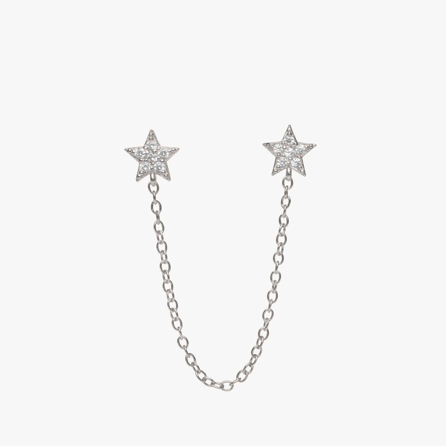Two separate pavé star posts connected by a silver chain. color:silver