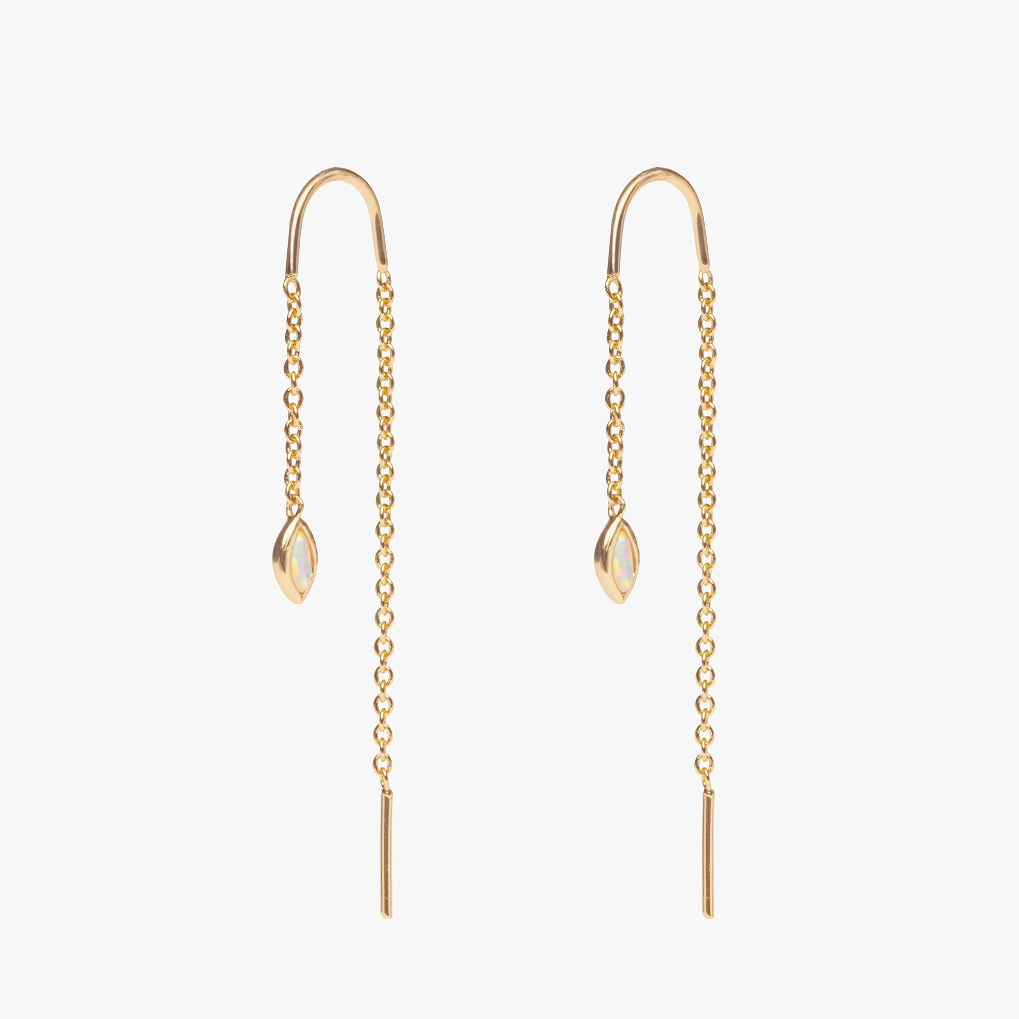 The teardrop threader is a gold chain with a opal gem on the end that dangles off the ear. [pair] color:gold/opal