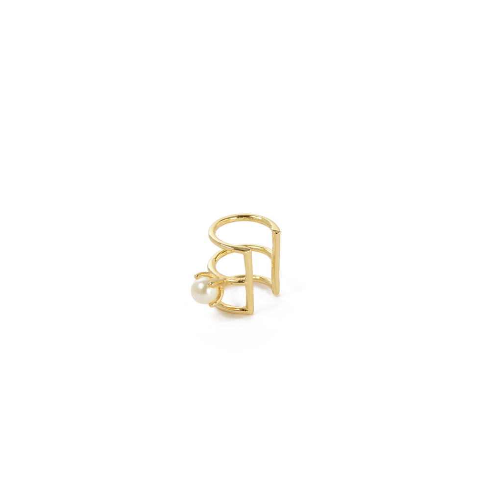 The pearl caged cuff is a cuff earring with a single pearl detail.