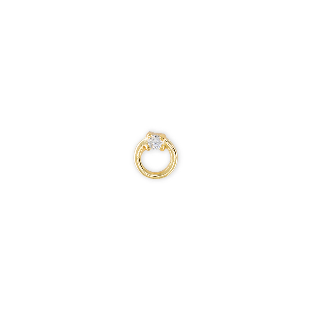 This stud is a cutout circle in gold with a small clear gem located at the top of the circle.