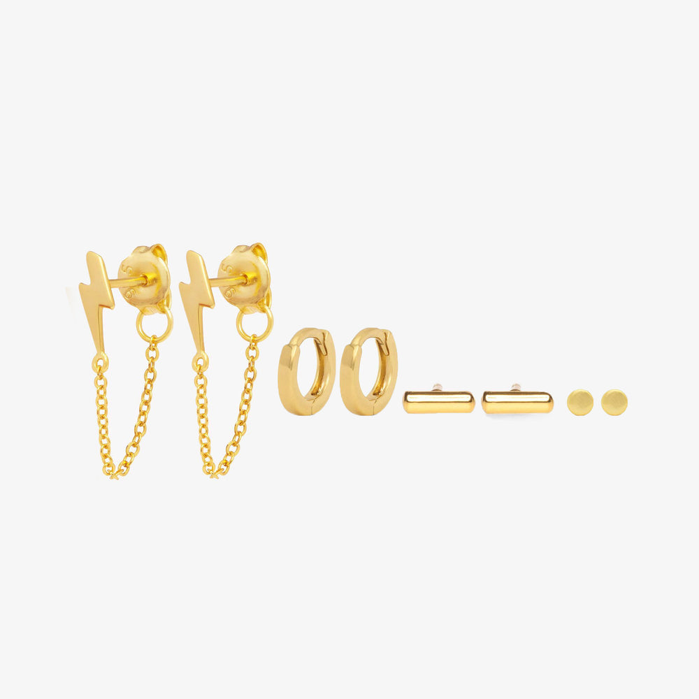 Gold Pair of lightning studs with linked front to back chain, pair of micro square edge huggies, pair of bar studs, and pair of flat circular dot studs.
