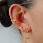 Gold Pavé butterfly drop hoops and attached chained pavé butterfly studs.