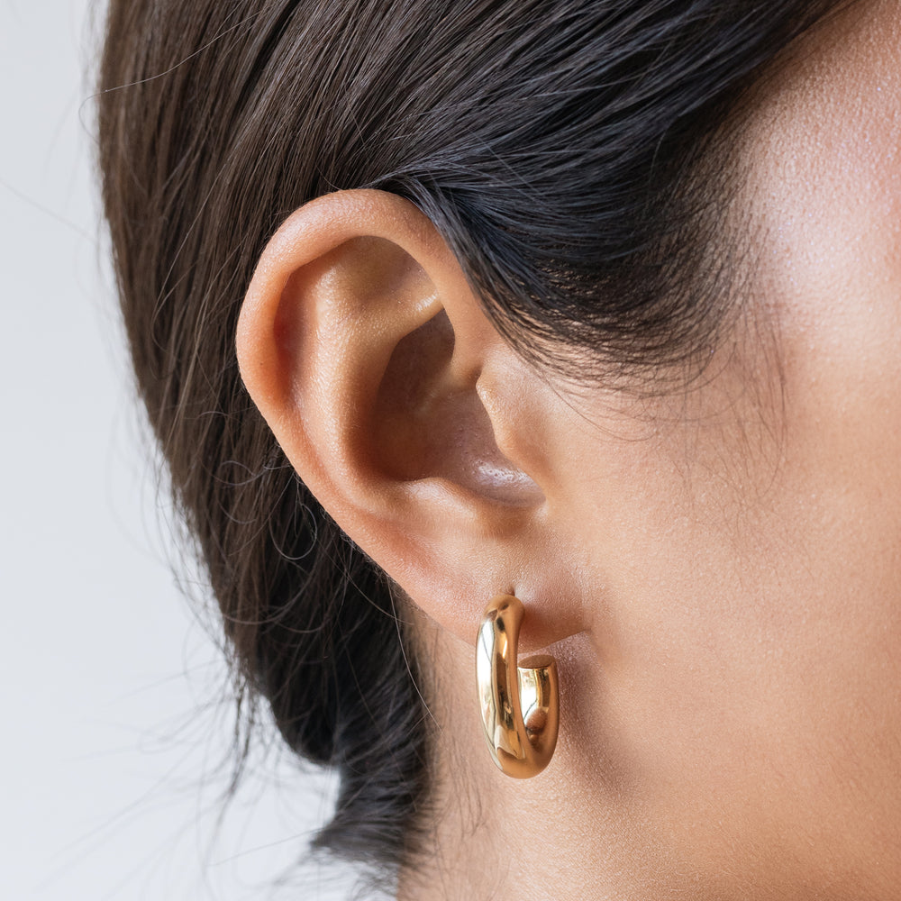 Tube-like medium hollow hoops. [hover] color:gold