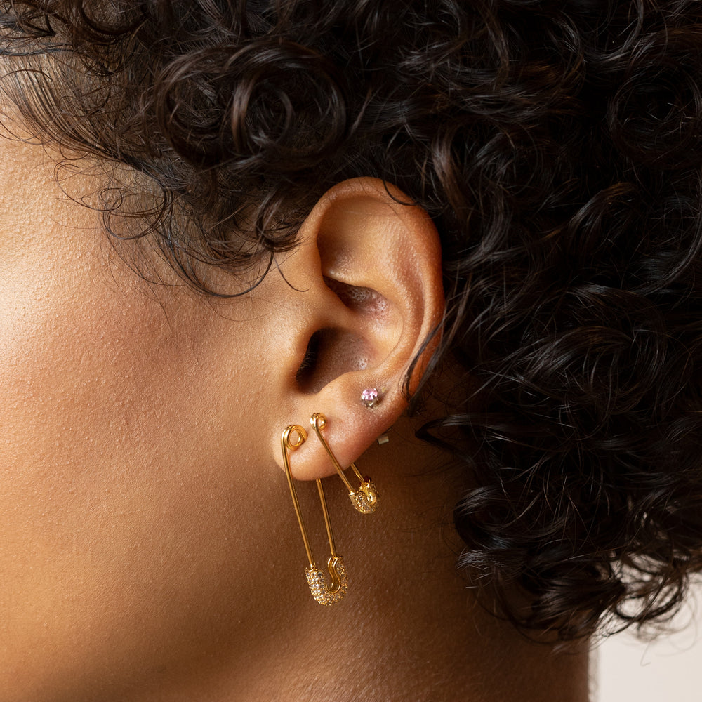 "Large safety pin earring with CZs along the top ""fastener"". color:gold"