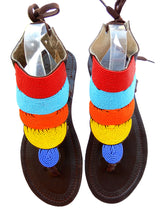 Load image into Gallery viewer, multi colour sandals front view. They are hand beaded and have a strong leather sole.