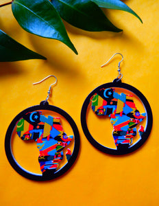 african flag earrings on yellow background
