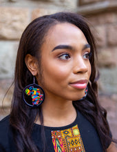 Load image into Gallery viewer, African fabric earrings on model.