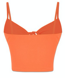 This zesty crop top in orange features an O ring, drawstring, and tunnel front. The fabric is super soft.   Fabric: 96% Polyester / 4% Spandex Made in the US