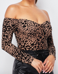 Our leopard off the shoulder bodysuit will give off that vibe. It features built-in padding.