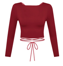 Load image into Gallery viewer, Show off some skin in this burgundy crop top! It features cross back detailing with a wrap tie.   Material: 96% POLYESTER 4% SPANDEX Made in the USA