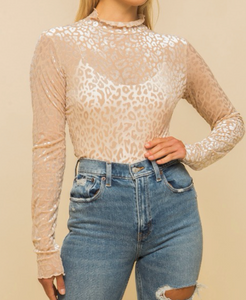 Velvet is timeless! We are loving this beige leopard print top with! Gold tip: Style with neutral heels, soft curls, and some hoops!  67% Polyester 23% Nylon 10% Spandex