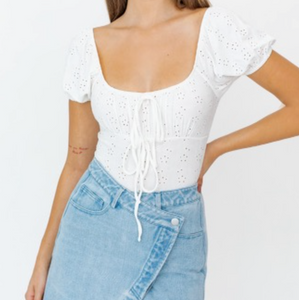 An effortless eyelet bodysuit that will be perfect for your Spring outfits.  93% Polyester 7% Spandex