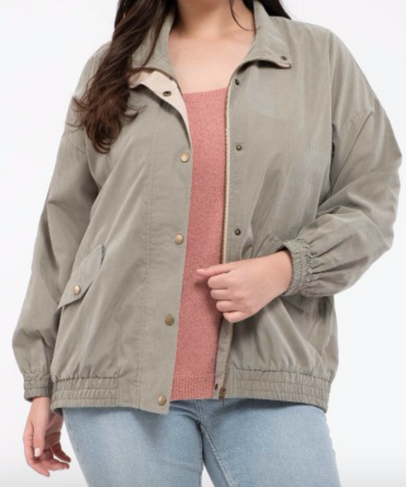 This light weight  jacket features a zipper, button closures, front pockets, elasticized bottom waist, and arm cuffs. <3