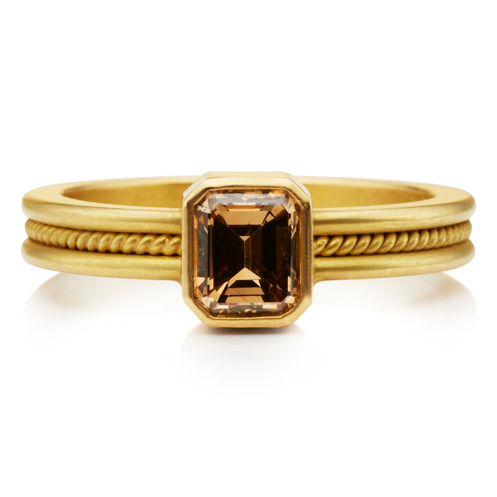 Single Braid Ring with an Emerald-Cut Brown Diamond