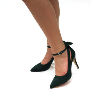 Accented by triangular cutouts at the quarter and smooth style lines leading to the counter. Featuring a unique 3 in 1 style option. A removable ankle strap and detachable bow for fun. This pump exhibits a classy chic aesthetic with a luxurious kidskin upper. Leveling on a 3.5-inch stacked cone heel and a supple kidskin leather padded insole for superior comfort.