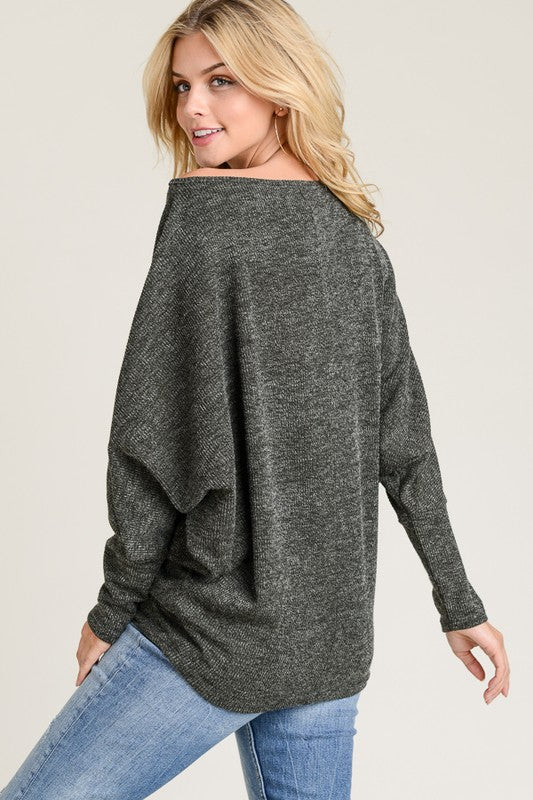 TWO TONE SWEATER WITH A BOAT NECKLINE AND LONG DOLMAN SLEEVES MADE IN USA 85% POLYESTER 10% RAYON 5% SPANDEX