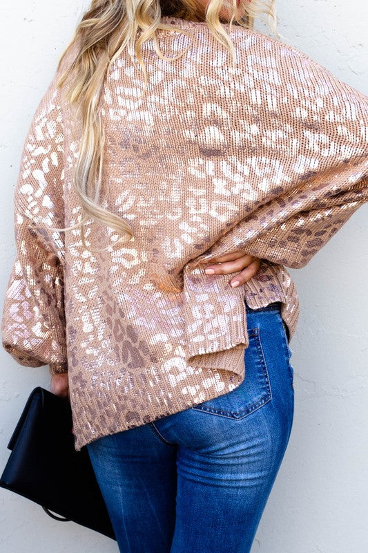 So comfortable and different from your average animal print!  Pink Gold Leopard Printed Ballon Sleeve Pullover Sweater.